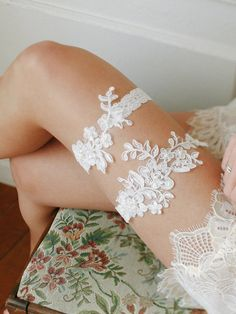 Lovely alecone lace has been beaded with clear sequins and ivory pearls for extra sparkle and texture. Hand-sewn to non-slip stretchy lace band, this garter set will stay comfortably on your leg all day & night! Our stretchy lace band for linegerie wear has been specially made for non-slip. Try and youll love it! • hand made-to-order in our studio. • ivory lace appliques on stretchy non-slip lace band. • comes with a fabric pouch.