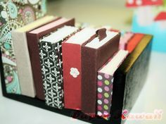 You should squash your books somewhere so that they loose they're springiness!!! You can see that different sized paper will make lots of different sized books, it is very addicting.