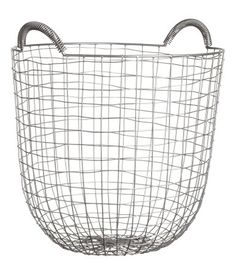 Black. Large metal wire basket with two handles at top. Diameter at base 5 3/4 in., diameter at top 14 in., height 13 1/4 in.