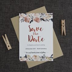 "These exquisite rose gold and watercolour flower save the dates are a lovely way to ask your loved ones to the save the date for your wedding. A beautiful bough of peonies and other delicate florals has been designed to adorn your Save the Date card with stunning tones of peach-pink and dusky blue. This sets off the lovely rose gold tones the ""Save the Date"" announcement is printed in. Printed on a soft uncoated cardstock reminiscent of watercolour paper."