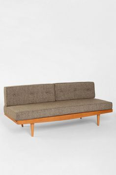 Mid-Century Sofa in a pretty berry color. Has anyone owned any of their pieces? the reviews for UO in general are a bit rough.