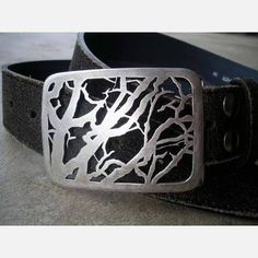 The Autumn Sky Belt Buckle evokes the stark yet beautiful vista of bare branches entwined in darkening October twilight. Carrie Bilbo handcrafts the silver belt buckle from sterling silver and bronze to create a stunning and stylish statement for men and women.