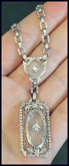Antique Art Deco diamond, camphor glass, and white gold filigree necklace at Ageless Heirlooms. Via Diamonds in the Library.