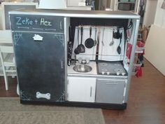An old entertainment center is now this cool chef's kitchen to delight 2 little boys.