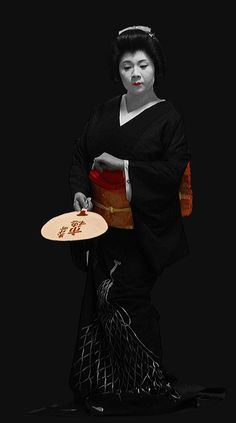 """Image 1 of 3: """"The geiko Ichiho elegantly dancing a traditional piece up in the second floor of Adachi in the Pontocho district of Kyoto."""" Text and image by photographer Rekisha no tabi of Flickr"""