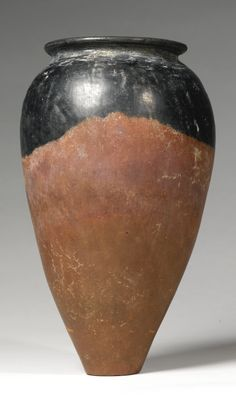 An Egyptian Black-Topped Redware Jar, Predynastic Period, Naqada II, 3600-3200 B.C.