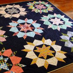 Swoon Quilt - going to make a second quilt like this, using dark gray as background, and reds, creams, and lighter grays as the stars