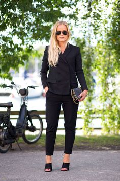 Suit, mules, Stella clutch.