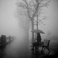 The grainy B&W photo uses the low resolution to maximize the fog, to create a dark solitary scene.