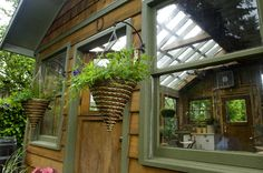 """""""Made from recycled materials, including 11 matching double-hung windows, three doors from friends and a concrete laundry tub for potting."""""""