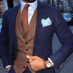 Brown is extremely hard color to match with suits but it works with blue (and beige). Such a great stylish and different three piece. Use vests to bring colors and patterns to your suit. For more awesome suits check out my tumblr at...