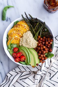 BBQ Chickpea and Crispy Polenta Bowls with Asparagus and Ranch Hummus —four varieties of vegetables — asparagus, arugula, tomatoes, and avocado — round out this hearty meal in a bowl, via @hbharvest