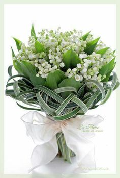 Lovely lily of the valley bouquet with grass.