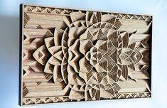 3D-композиция, вырезанная из деревянной фанеры.