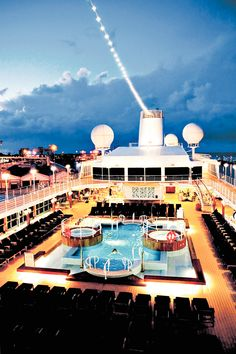 On board the Azamara Club cruise liner. Luxury swimming pools, stunning lighting and a soothing night sky.