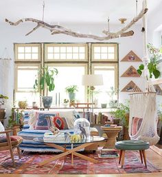 """Time for another #FindYourStyle, and this time we're going """"Global."""" If you love an eclectic bohemian mix and aren't afraid to get a little wild with your decor, then this might be the post for you.  of @emily_katz's living room, shot by @davidtsay for #STYLEDthebook."""