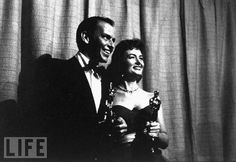 Donna Reed and Frank Sinatra: 1954's Best Backup From Here to Eternity costars Frank Sinatra (Best Supporting Actor) and Donna Reed (Best Supporting Actress) pose for the press backstage at the old Oscars venue, the RKO Pantages theater.