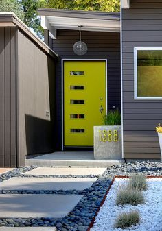 The bright chartreuse door gives this MCM entry real pop!