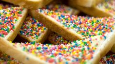 """O-M-G It's Fairy Bread! Fairy bread is an Australian food. basically just plain white bread cut into triangles, spread with butter, and little """"hundreds and thousands"""" (Aussie term for 'sprinkles'). They look amazing! Lila Party, Ben Y Holly, Fairy Bread, Fairy Tea Parties, For Elise, Australian Food, Australian Party, Pamper Party, Tea Party Birthday"""