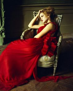 º-he- found her in an adjoining room in the long hallway, slouched her in rich red dress on a regal chair next to a reading table, with her hair thrown up in a messy bun, her elbow propped up on the arm of the chair and her hand on her forehead, looking off into space.