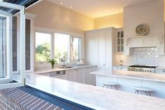 Bi-fold windows leading out onto deck with a large table.