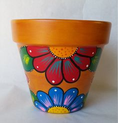 I like this >> Pottery, hand painted flower pot, rustic flower pot, painted clay pot, planter, painted planter, rustic pot, patio decor, pot for plants