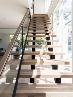 Open tread stairs let light in from high above. S&A Stairs · Park Street Open Stairs, Entry Stairs, House Stairs, Steel Stairs, Wood Stairs, Stair Railing, Railings, Timber Handrail, Staircase Runner