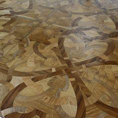 Pavimenti multimaterici intarsiati, Parchettificio Toscano