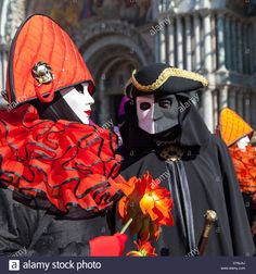 Woman Dressed As Harlequin And Man In Bauta Mask At St. Mark's ...