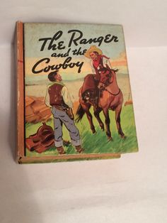 I'm sold. #Antiquarian children's Book published in 1939 - The #Ranger and The #Cowboy hardcover, collectible book. Available now from Soaring Hawk Vintage on #Etsy #vintagebooks #vintage #vintagefiction #blb #rarebooks