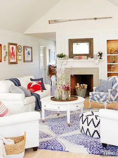 It's no surprise that this simple and sweet color scheme has been a go-to combination for generations. A staple of the early '90s, this room's blue-and-white color palette feels fresh when applied in modern patterns and as part of an eclectic design scheme.