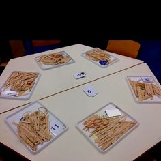 Math - group sticks into teen numbers making groups of tens with rubber bands and adding the extras