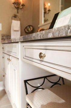 Antique brass knobs look gorgeous on these white bathroom cabinets and add the perfect amount of detail.