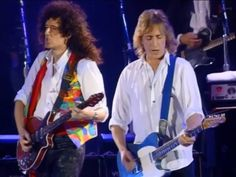 "Brian May (Queen) with Mick Ronson (The Spiders from Mars, Mott the Hopple) at ""Concert for Freddie Mercury"""