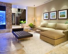 Bright living room in neutral colors with a wall decorated with natural stone and a marble floor  #marble #floor #home #interior #naturalstone