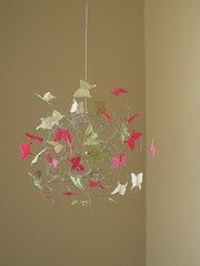 delicate butterfly crib mobile--I can picture 3 of these hung at varying levels in a corner of a room