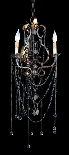More chain, less crystal = Gothic. This particular upstyled chandelier incorporates several religious medals with beaded chains.