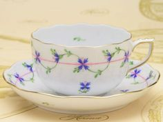 HEREND Hungary floral decoration of small Cornflowers tea cup and saucer