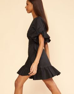 c7af1db2650 Polished cotton ruffle wrap dress. - Short sleeves - Fitted to high waist -  Wrap