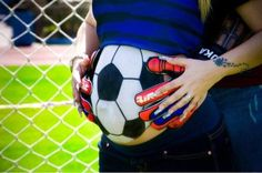 Pregnant belly hand painted as a soccer ball