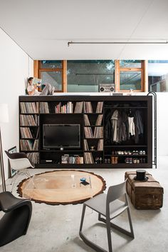 iDesignMe-The living cube-6 http://idesignme.eu/2013/08/the-living-cube/ #cube #interiors #design #wood #interior #interiordesign #decoration #decor  #black #smallspaces #small  #bookshelf #book #tv #television