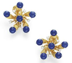 A PAIR OF LAPIS LAZULI, DIAMOND AND GOLD EAR CLIPS, BY JEAN SCHLUMBERGER, TIFFANY & CO.  Each designed as a flower, the sculpted 18k gold petals set with cabochon lapis lazuli, accented by circular-cut diamonds, mounted in 18k gold and platinum  Signed Tiffany & Co., Schlumberger Studios for Jean Schlumberger
