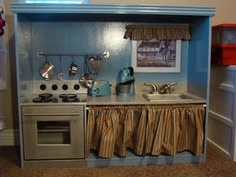 Transform an entertainment center into a child-sized kitchen.  Tutorial by Cupkateer.