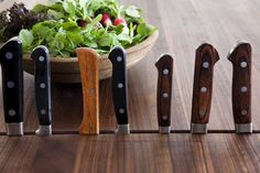 Knife storage slots are built into this John Boos oiled walnut kitchen island countertop.