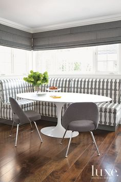 Berg kept the lines of the new banquette seating area simple to focus attention on the graphic Christopher Farr Cloth fabric. The shade fabric is from Pierre Frey.