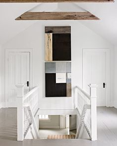 Attic:  clean + simple lines; symmetrical closets; white floors; detailed / elegant stair railings; open ceiling above beams; brilliant way to separate boys' room from girls'