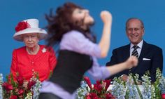 A photo catches Britain's queen looking impassive in the face of Canadian pageantry