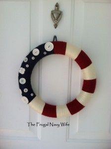 Patriotic yarn wreathe, july 4th yarn wreathe, patriotic wreathe, july 4th wreathe, red white and blue wreathe #diy #july4   I like the buttons for stars.