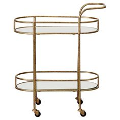 Gorgeous in antiqued gold. This retro drinks trolley makes serving up cocktails to your favourite guests, effortless.
