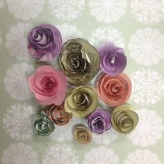 How to make rolled paper roses via @Guidecentral - Visit www.guidecentr.al for more #DIY #tutorials paper roses, roll paper